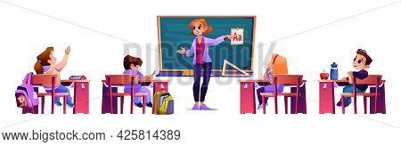 Elementary School Teacher Explaining Abc Material To Pupils Sitting By Desks. Educator By Blackboard