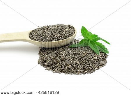 Chia Seeds In Wooden Spoon And Green Chia Leaves On White Background, Isolate