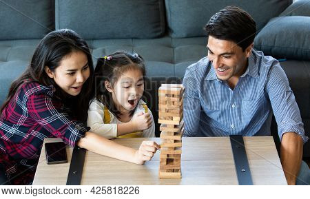 Mixed Race Family, Daughter And Caucasian Dad And Asian Mom, Playing Wood Game Together With Fund An