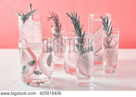 Summer Alcoholic Cocktail. Refreshment Lemon Soda Drink. Gin And Tonic With Lime And Rosemary On Pin