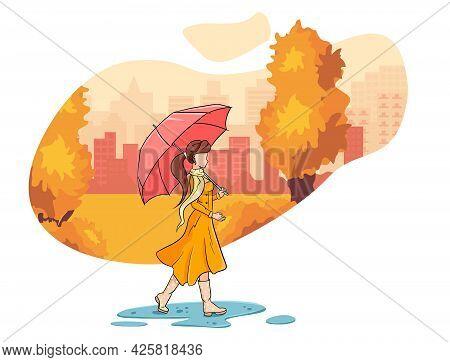 A Girl With An Umbrella Walks Through The Autumn Park.