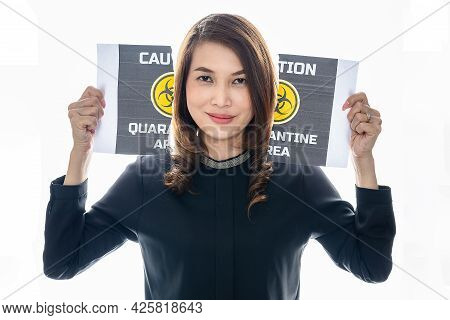 Woman Shows Her Happy Face Between Pieces Of Torn Paper With Covid-19 Quarantine Area Words. The Ide