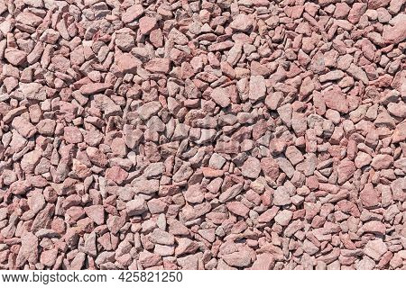 Small Section Of The Ground Covered With Gray-red Granite Rubble Outdoors, Top View Close-up