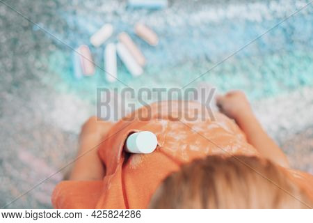Close Up Dirty Chalk Stains On Children's Clothes. A Group Of Colored Chalk And A Painting Rainbow O