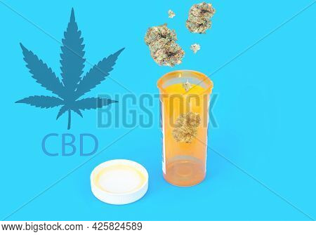 A Bud Of Medical Marijuana For The Dispensary Menu. A Bottle Of Dry Medical Cannabis On A Blue Backg