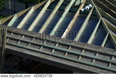 Wood roof trusses. House construction.