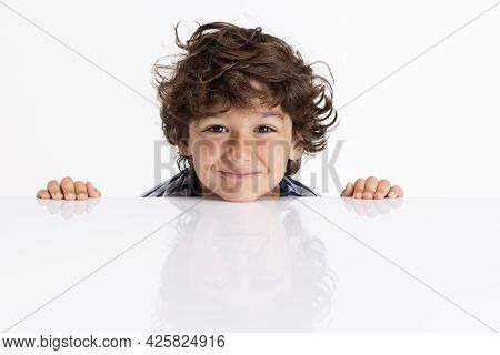 Close-up Portrait Of Caucasian Preschool Boy Isolated On White Studio Background. Copyspace. Childho