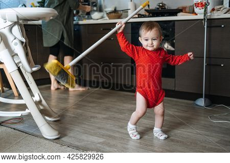 Little Mothers Helper. Cute Toddler Baby Girl With Mop Help Her Mom Do Housework In Kitchen. Cute Li