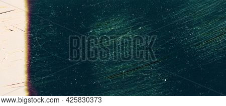 Blank Grained Toned Film Strip Texture Background With Heavy Grain, Dust And Light Leak