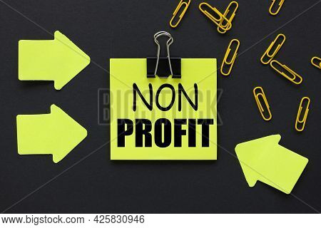 Non Profit. Text On A Black Background, On A Bright Yellow Sticker