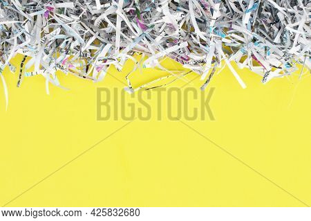 The Shredded Paper On Light Yellow Background.