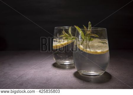 Two Gin And Tonic With Mint And Lemon On A Black Background With Copy Space