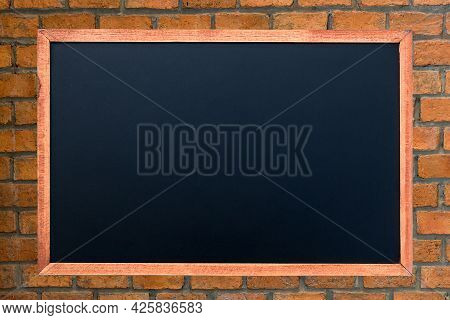 Empty Green Chalkboard Texture Hang On The Brick Wall. Double Frame From Green Board And Brick Backg