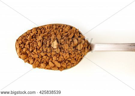 Instant Coffee Granules In A Spoon Isolate.