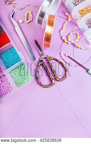 Creative Flatlay Of Different Seed And Pearl Beads With Tools For Making Jewelry, Wire String, Sciss
