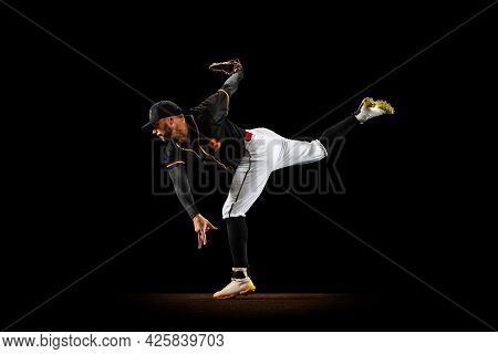 Professional Baseball Player, Pitcher In Sports Uniform And Equipment Practicing Isolated On A Black