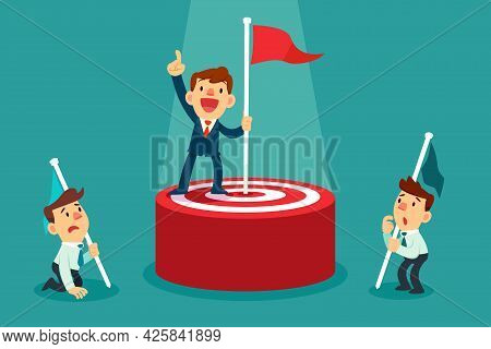 Successful Businessman Holding Flag On Top Of Target Winning Against The Competition. Setting Goal B