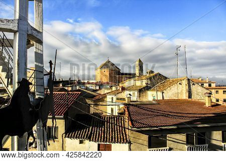 Panoramic Of Alborea Village At Sunrise. Old Church In The Background And Windmill In The Foreground