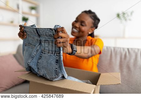 Black Lady Unboxing Delivery Package After Online Shopping, Happy With Received Item, Satisfied With