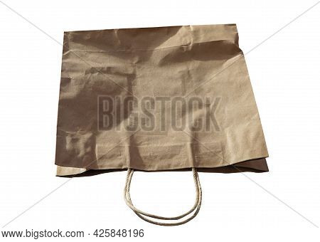 Brown Paper Bag Recycle Isolated On A White Background. Recycled Paper Shopping Bags. Ecology Concep