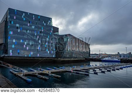 Harpa Concert Hall, On Cloudy, Stormy Day, Reykjavik, Iceland. 5 July, 2021. The Building Has A Dist