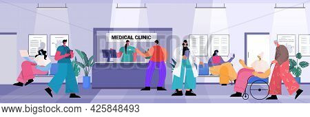 Patients And Medical Clinic Workers In Hospital Corridor Healthcare Concept Full Length Horizontal