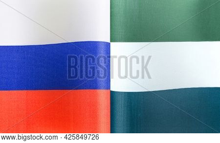 Fragments Of The National Flags Of Russia And The Republic Of Sierra Leone Close-up