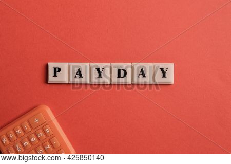 Square Letters With Text Payday Isolated On Red Background