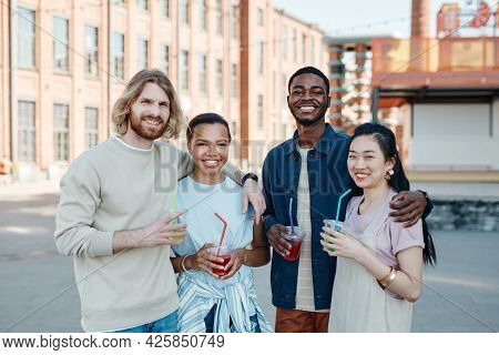 Waist Up Portrait Of Diverse Group Of People Smiling At Camera While Enjoying Summer In City