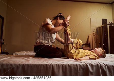 Professional Masseuse Working In Modern Spa Salon