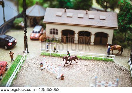 Miniature People. Miniature Models Of Horse Rider Training. Horseback Riding. Miniature Models As A