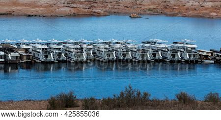 Page, Arizona, Usa - October 31, 2014:  A Row Of Sightseeing Cruise Boats Docked In Antelope Point M