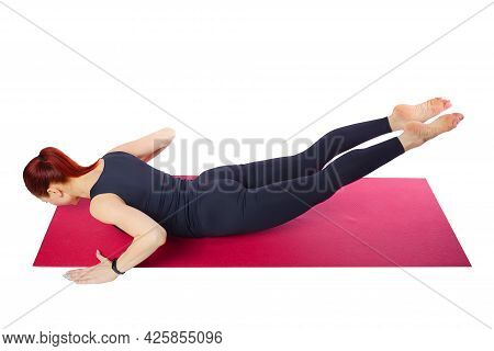Pilates Or Yoga. A Slender Athletic Girl Performs An Exercise To Strengthen The Back Muscles. Wellne