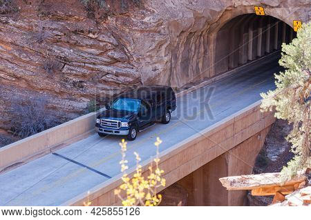 Zion National Park, Utah / Usa - November 7, 2014:  A Truck Driving Out Of The Tunnel And Onto A Bri