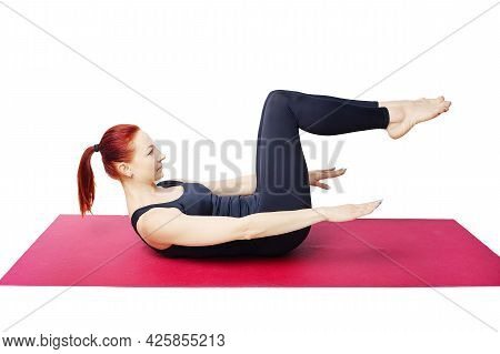 Pilates Or Yoga. A Slender Girl Shows The Starting Position For Exercises To Strengthen The Abdomina