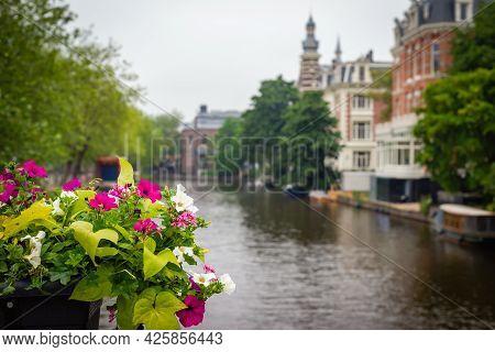 June 30, 2021, Amsterdam, Netherlands, The Inscription On The Museumbrug Bridge. The Historic City C