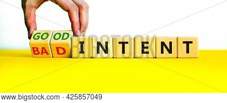Good Or Bad Intent Symbol. Businessman Turns Wooden Cubes And Changes Words 'bad Intent' To 'good In