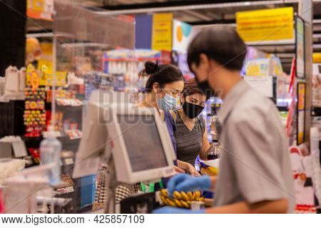 Lesbian Couple In Protective Mask Check Out At Cash Register In Grocery Store