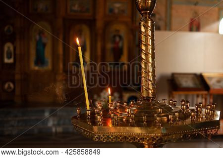 The Ritual Of Baptism. A Beautiful Christian Church Painted On The Walls Icons. Candle Stand, Smoke