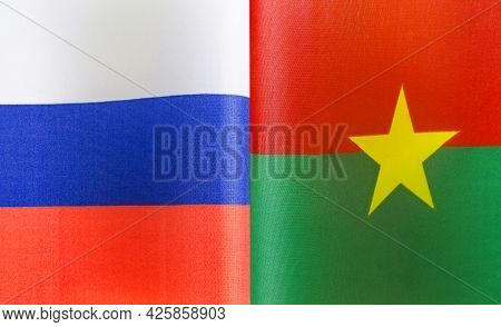 Fragments Of The National Flags Of Russia And Burkina Faso Close-up