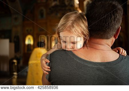 The Ritual Of Baptism. A Beautiful Christian Church Painted On The Walls Icons. Child In The Arms Of