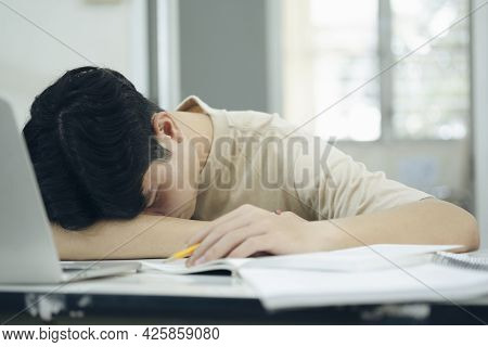 Tried Student Fell Asleep While Doing Homework With The Laptop