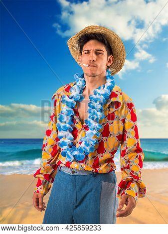Young Man Smoking Cigarette On Beach, With Hippie Clothing