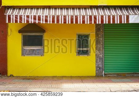 Colorful Vintage Facade Of A House. Old Building Wall Yellow Color. Nha Trang, Vietnam