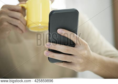 Young Man Using Mobile Phone. Using Online Connect Technology For Business, Education And Communicat