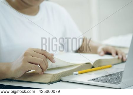 Reading A Book. Education, Academic, Learning Reading And Exam Concept.