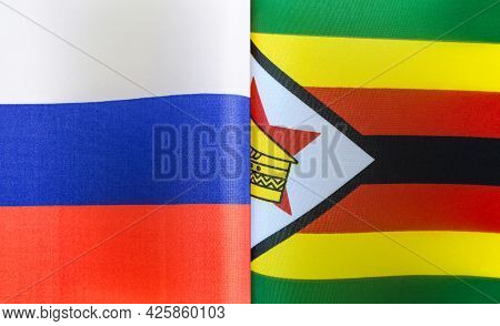 Fragments Of The State Flags Of Russia And The Republic Of Zimbabwe Close-up