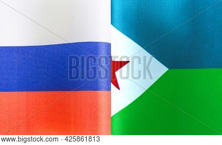 Fragments Of The National Flags Of Russia And The Republic Of Djibouti Close-up