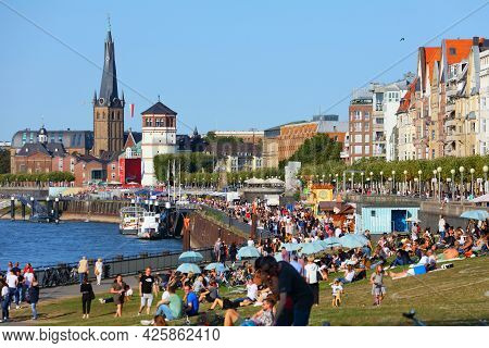 Dusseldorf, Germany - September 19, 2020: People Visit River Rhine Waterfront In Dusseldorf, Germany