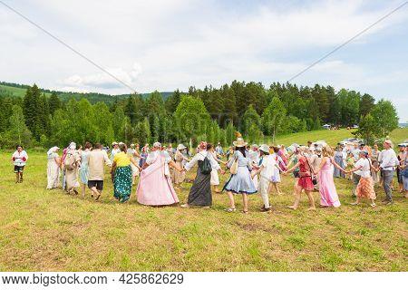 Krasnoyarsk, Russia - June 19, 2021: People Holding Hands Drive A Round Dance During The Celebration